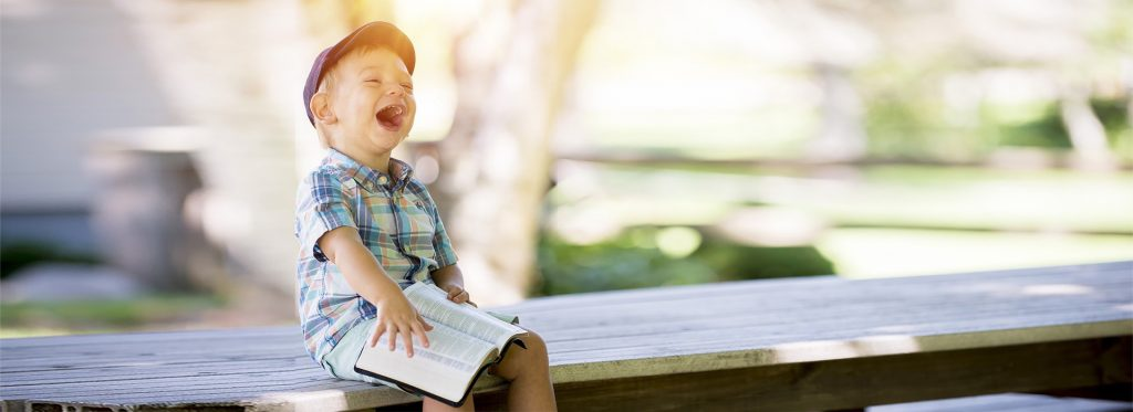 Child enjoys learning by reading story.